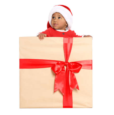 Festively dressed African-American baby in Christmas gift box on white background Stok Fotoğraf