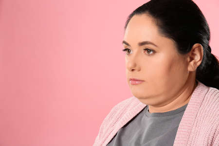 Woman with double chin on pink background. Space for text