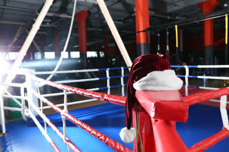 Santa hat in corner of boxing ring 写真素材