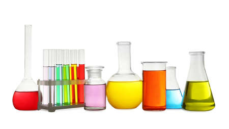 Laboratory glassware with colorful liquids on white background