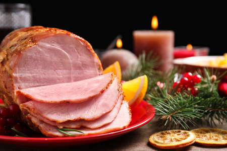 Plate with delicious ham served on wooden table, closeup. Christmas dinner