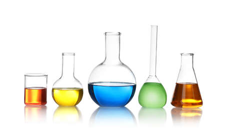 Laboratory glassware with color liquids on white background