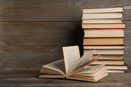 Stack of hardcover books on wooden table. Space for text Stockfoto