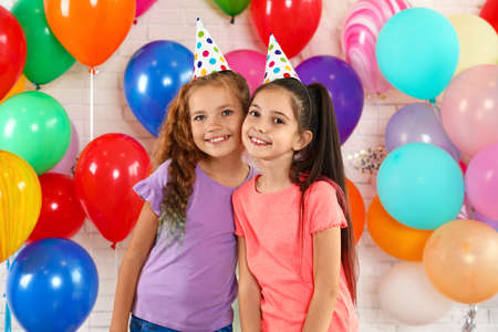 Happy children near bright balloons at birthday party indoors Imagens