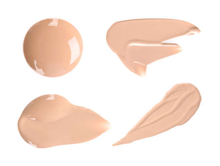 Set with samples of liquid foundation on white background, top view Imagens