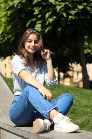 Beautiful young woman outdoors on sunny day