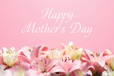 Beautiful lily flowers and text Happy Mother's Day on pink background, top view