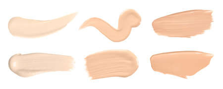Set of different foundation shades on white background, top view 免版税图像