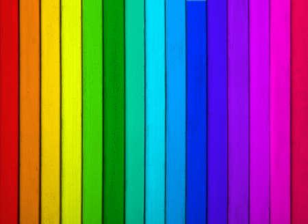 Textura de la superficie de madera del arco iris como fondo, vista superior