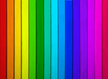 Texture of rainbow wooden surface as background, top view