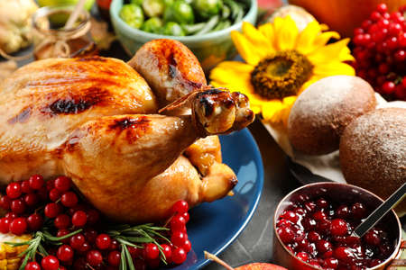 Composition with delicious turkey and autumn vegetables as background, closeup. Happy Thanksgiving day