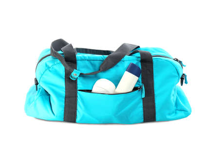 Sport bag with deodorants on white background