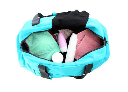 Sport bag with deodorants and clothes on white background, top view 写真素材