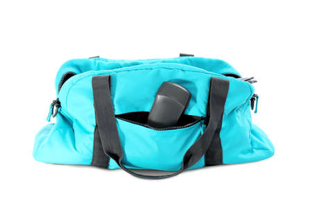 Sport bag with deodorant on white background