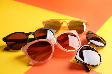 Stylish sunglasses on color background. Summer time Stock Photo