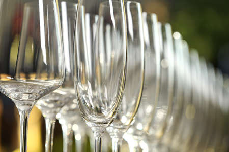 Set of empty glasses on blurred background, closeup