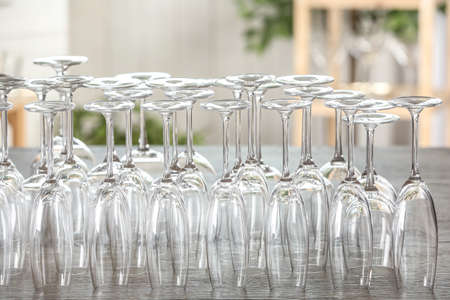 Empty glasses on wooden table against blurred background Zdjęcie Seryjne