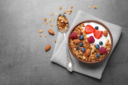 Tasty homemade granola  served on grey table, flat lay with space for text. Healthy breakfast Stok Fotoğraf