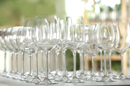 Empty glasses on table against blurred background