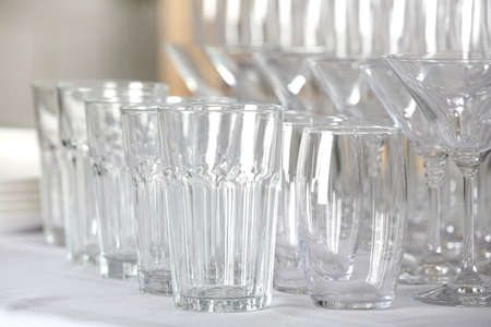 Set of empty glasses on table indoors