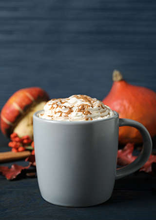 Cup with tasty pumpkin spice latte on blue wooden table Stock fotó