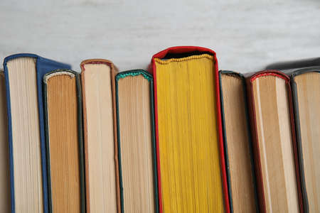 Stack of hardcover books on white background, closeup