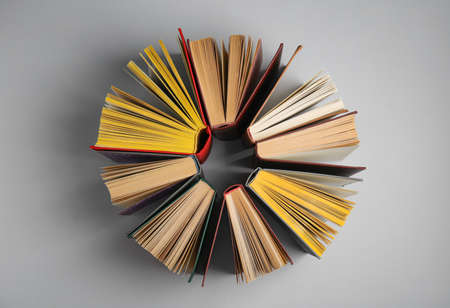 Circle made of hardcover books on grey background, flat lay Stock Photo