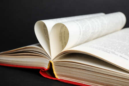 Closeup view of open book on black background Stok Fotoğraf