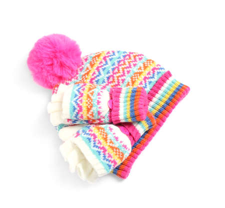 Warm knitted hat and mittens on white background, top view Stock Photo