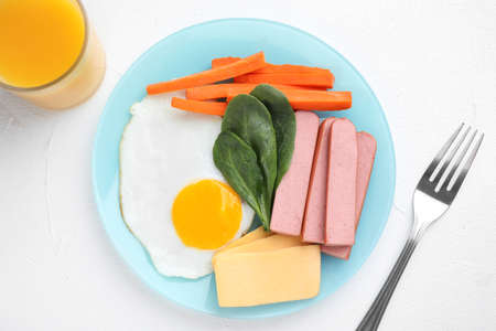Flat lay composition with egg and cheese on white table. Breakfast for kids Stok Fotoğraf
