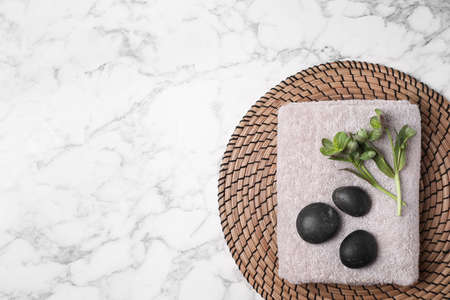 Flat lay composition with spa stones, towel and space for text on white marble background Фото со стока - 131840939