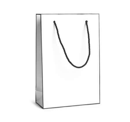 Paper shopping bag with handles on white background. Mockup for design