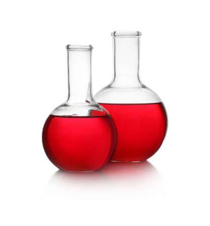 Florence flasks with red liquid on white background. Laboratory glassware Banco de Imagens