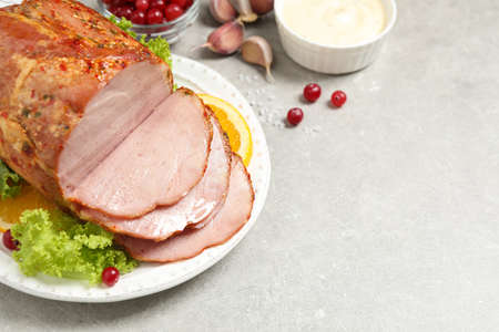 Delicious ham served with garnish on grey table, above view. Space for text Zdjęcie Seryjne