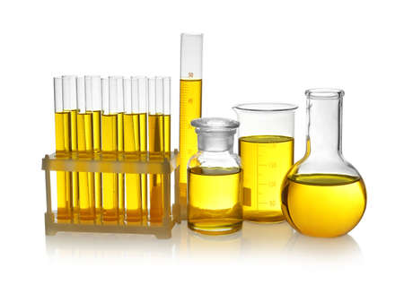 Laboratory glassware with yellow liquid on white background Banco de Imagens