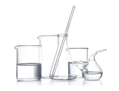 Laboratory glassware with liquid samples on white background