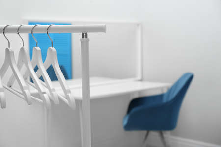 Wardrobe rack with clothes hangers in dressing room 写真素材