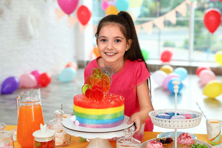 Happy girl in room decorated for birthday party