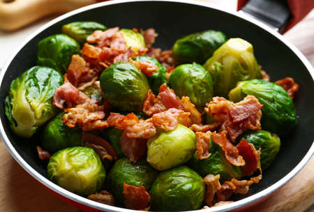 Tasty roasted Brussels sprouts with bacon in frying pan, closeup Stock fotó