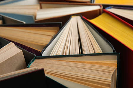 Stack of hardcover books as background, closeup