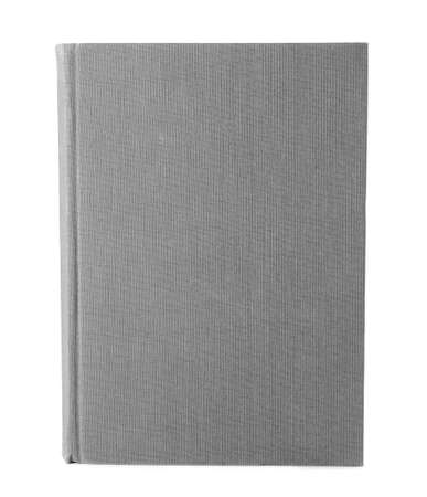 Book with blank grey cover on white background 版權商用圖片