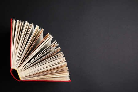 Hardcover book on black background, top view. Space for text Stock Photo