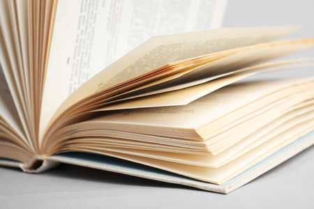 Closeup view of open book on light background