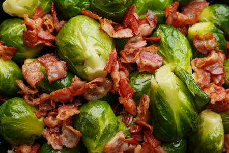 Tasty cooked Brussels sprouts with bacon as background, top view Stock fotó