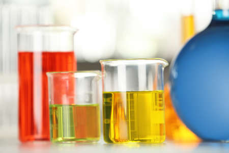Glassware with color liquids on table in laboratory