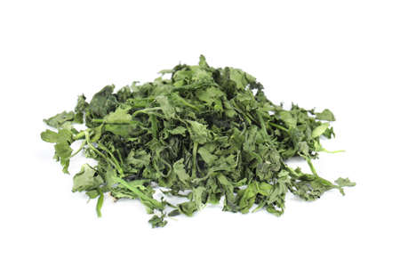 Heap of dried parsley on white background