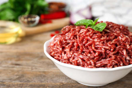 Fresh raw minced meat on wooden table, closeup Stock fotó