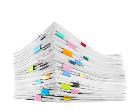 Stack of documents with colorful binder clips on white background