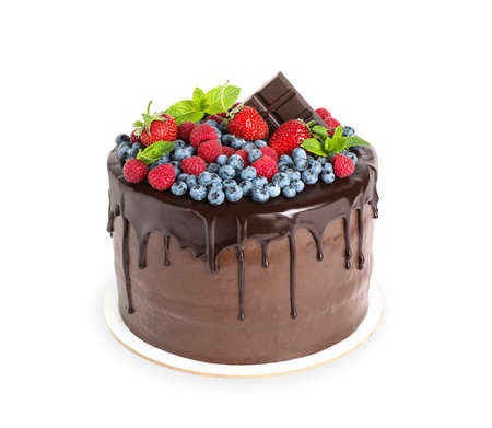 Delicious chocolate cake decorated with fresh berries on white background