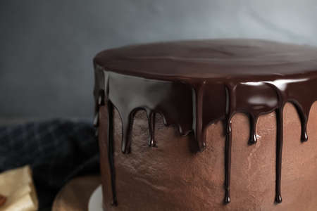 Freshly made delicious chocolate cake against grey background, closeup Stock fotó